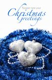Silver Christmas hearts on blue Royalty Free Stock Photography