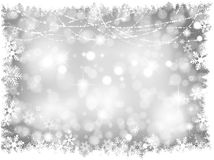 Silver Christmas lights Background. Decorative silver lights Christmas background with snowy border Stock Images
