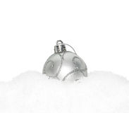 Silver Christmas New Year bauble, ball lying on the white snow Royalty Free Stock Photos