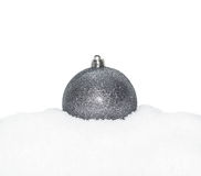 Silver Christmas New Year bauble, ball lying on the white snow, Stock Photos