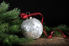 Silver Christmas Ornament with Red Ribbon Stock Image