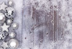 Silver Christmas ornament side border with snow frame on wood Royalty Free Stock Photos