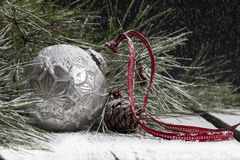 Silver Christmas Ornament in Snow Stock Photography