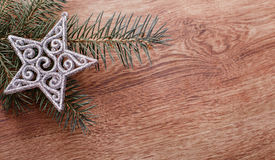 Silver Christmas ornaments and fir tree branch on a rustic wooden background. Xmas card. Happy New Year. Top view Stock Image