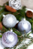 Silver Christmas ornaments in leaves Stock Images
