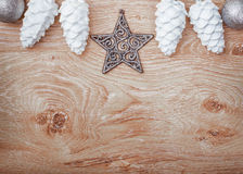 Silver Christmas ornaments on a rustic wooden background. Xmas card. Happy New Year. Top view with copy space Stock Photography
