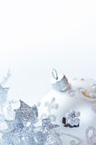 Silver christmas ornaments on white background Royalty Free Stock Photos