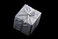 Silver christmas present. Stock Photos
