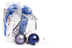 Silver christmas present with blue ribbons and chr Royalty Free Stock Image
