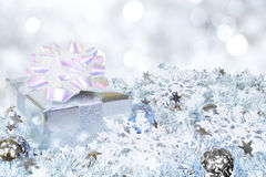 Silver Christmas scene. With gift box, baubles and abstract light background Royalty Free Stock Photos