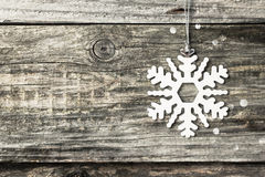 Silver christmas snowflake. Over vintage wooden background Stock Photos