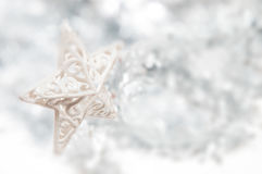 Silver christmas star with snow effect background. And sparkling silver stock images