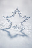 Silver Christmas star on snow Royalty Free Stock Photos