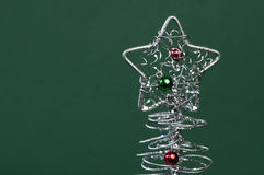 Silver Christmas tree. With ornaments. Green Background Stock Photos