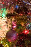Silver Christmas Tree Ball. A silver Christmas tree ball perched on a tree stock images