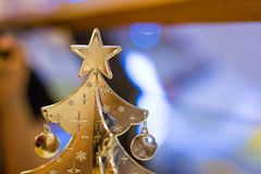 Silver christmas tree. With blurry background Stock Images