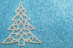 Silver Christmas tree decoration on blue background Stock Images