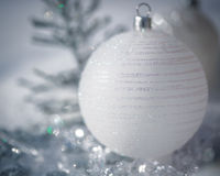 Silver Christmas tree decorations on snow Stock Photography