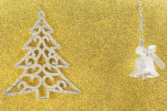 Silver christmas tree on golden background Stock Photos