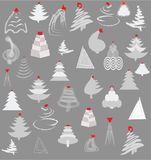 Silver Christmas Trees. Over grey background with red ornaments Royalty Free Stock Image