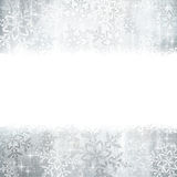 Silver Christmas, winter background with snowflakes. Silver and white snowflakes on a Christmas, winter card with copy space for your text Royalty Free Stock Photo