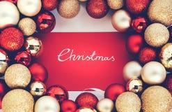 Silver CHRISTMAS writing and Christmas glass balls. royalty free stock photography