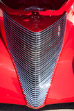 Silver chrome grill on red hot rod Stock Image