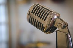 Silver chrome vintage microphone. Silver chrome metal vintage microphone stock photo