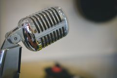 Silver chrome vintage microphone. Silver chrome metal vintage microphone stock image
