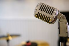 Silver chrome vintage microphone. Silver chrome metal vintage microphone royalty free stock photography