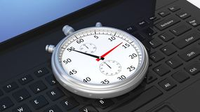 Silver chronometer on black laptop Royalty Free Stock Image