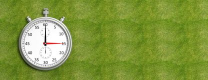 Silver chronometer. On green grass Stock Photo