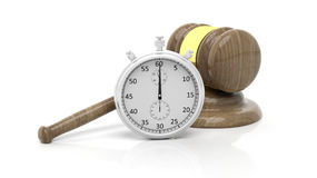 Silver chronometer with wooden gavel Royalty Free Stock Photos