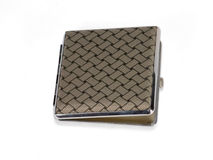 Silver Cigarette Box. Engraved silver cigarette case on white background Royalty Free Stock Photos