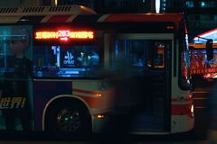 Silver City Bus on a City Street at Night Royalty Free Stock Photos