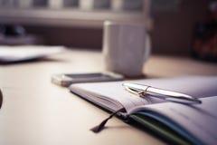 Silver Click Pen on Open Book Royalty Free Stock Photo