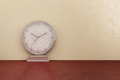 Silver clock. Silver watch on the marble floor Royalty Free Stock Photo
