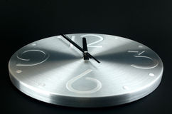 Silver clock on a  black background Stock Photos