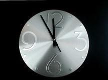 Silver clock on a  black background Stock Images