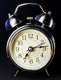 Silver clock, black background Royalty Free Stock Photography