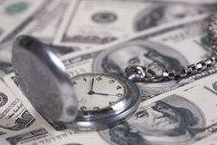Silver clock and money Stock Photos