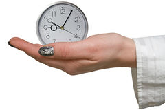 Silver clock in a woman hand Stock Photo