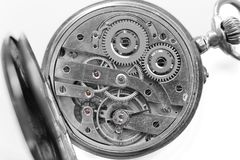 Silver Clockwork on white background. Detail of watch machinery. Old mechanical pocket watch. Macro shot. Stock Image