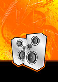 Silver club speakers. Metallic silver speakers set against an orange scratched grunge background Stock Image
