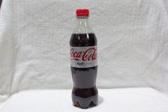 A Coca Cola Bottle. A silver Coca Cola bottle in a studio royalty free stock images