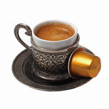 Silver coffee cup with capsule Royalty Free Stock Image