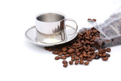 Silver coffee cut whole beans Royalty Free Stock Photos