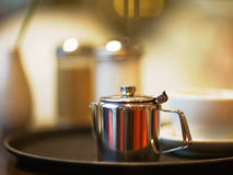 Silver Coffee Pot. On table, selective focus Royalty Free Stock Image