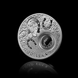 Silver coin with horseshoes on black Stock Images