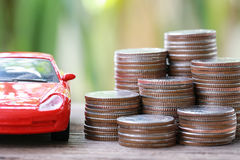 Silver Coin Of Pile With Red Car Model In Concept Savings To Buy Stock Images